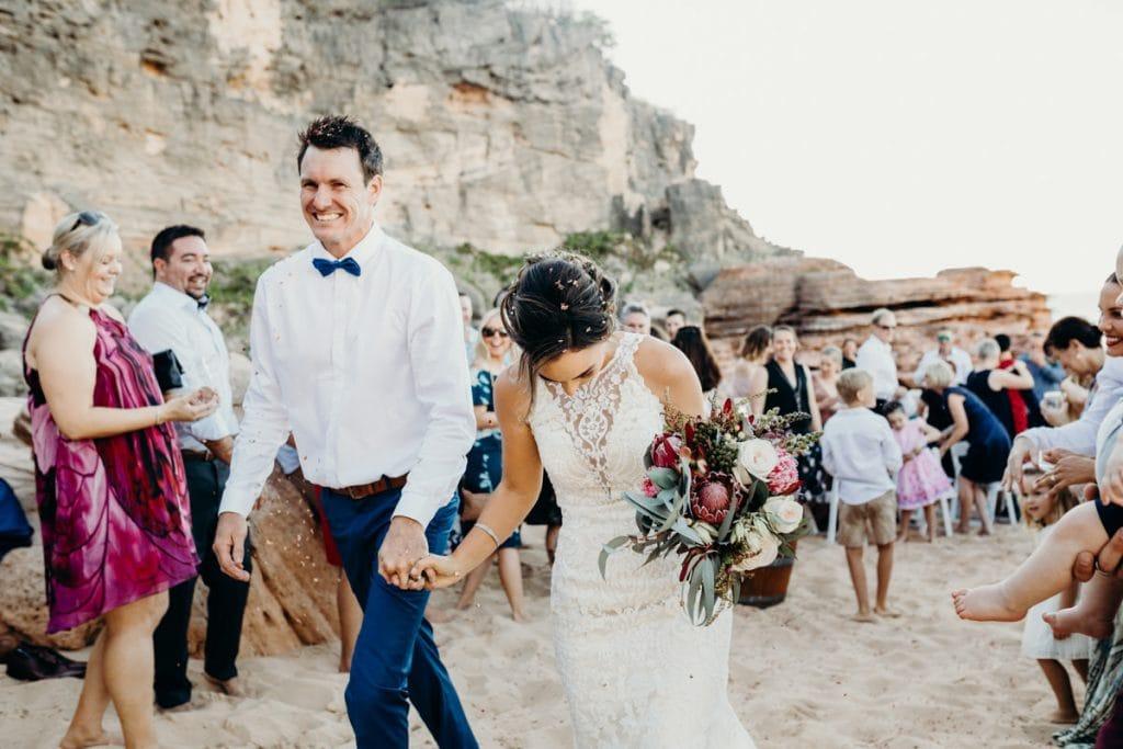 bride and groom walking down the aisle at beach wedding at Eco Beach Resort