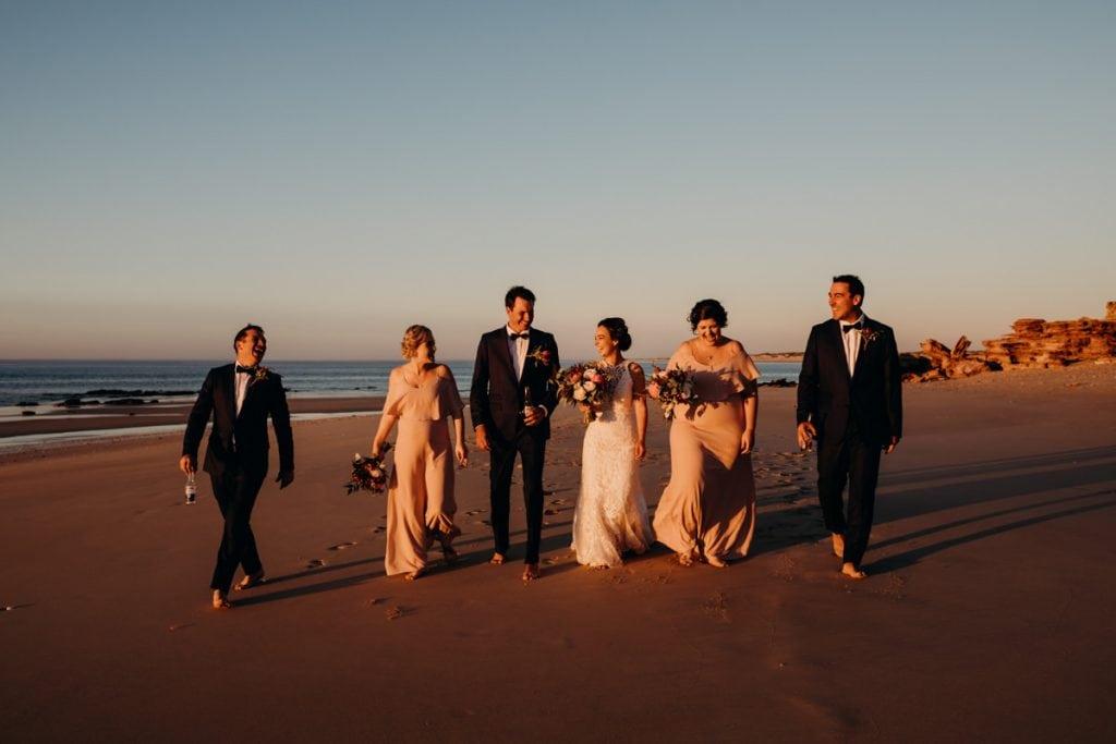 bridal party walking along Eco Beach