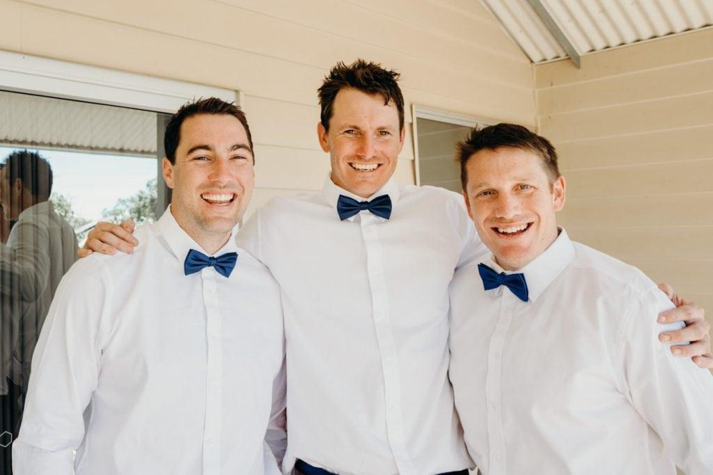 smiling groom with groomsmen at Eco Beach Resort villa