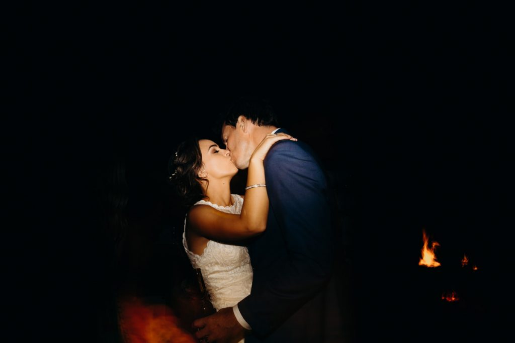 bride and groom kissing on the dance floor at Eco Beach Resort wedding reception
