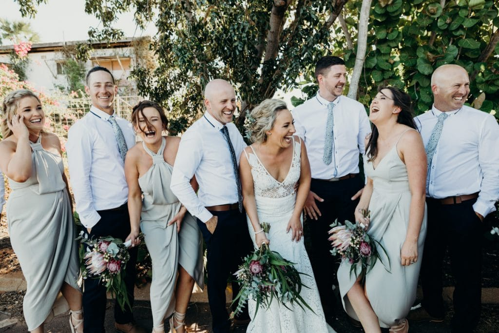 Broome photographer bridal party laughing standing in a line