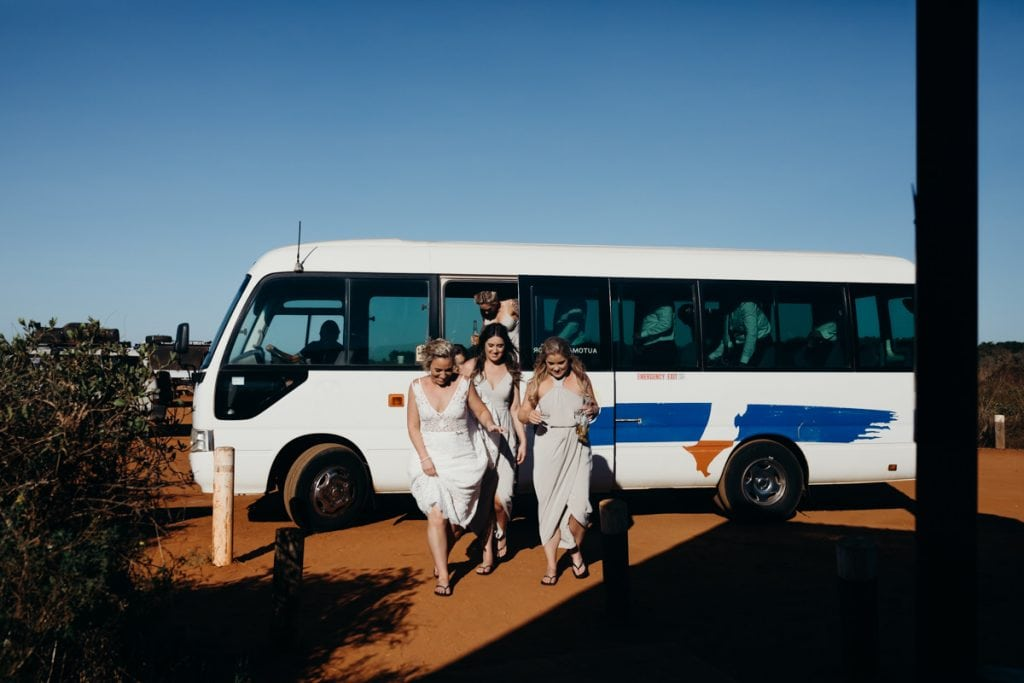 Bridal party steps out at town bus at Gantheaume Point on Broome wedding
