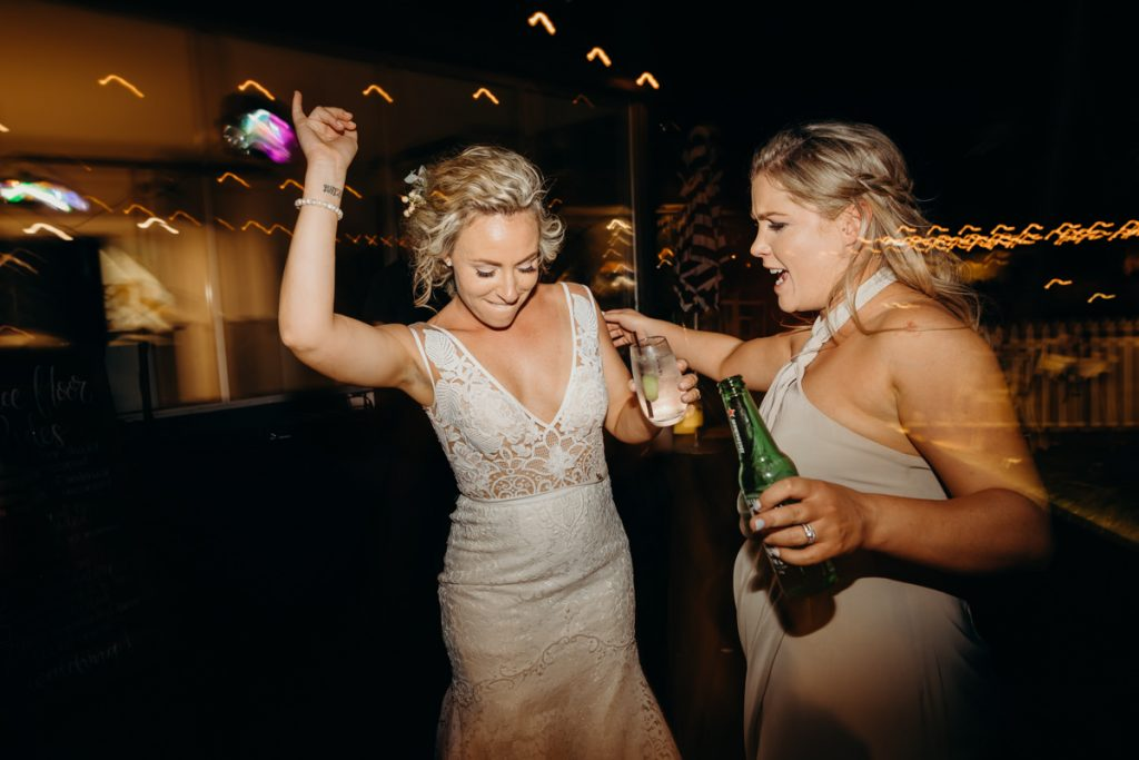 bride and friend dancing on dancefloor at Broome wedding