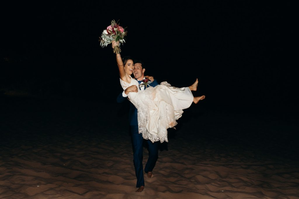 bride and groom entering the wedding reception at Eco Beach Resort