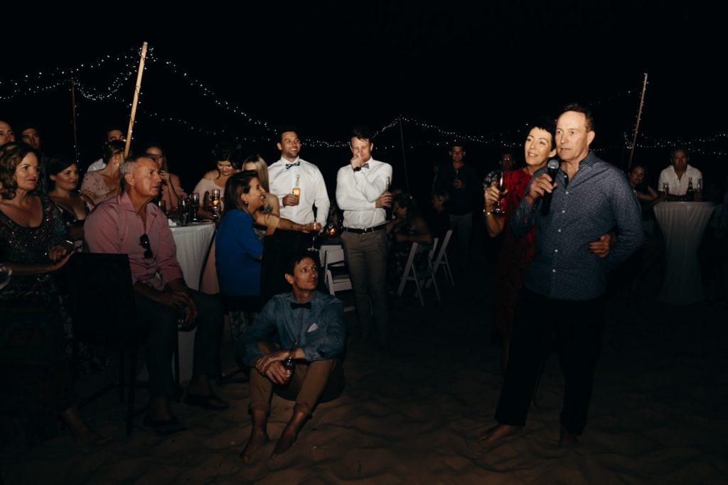 Father of the bride giving a speech on the beach