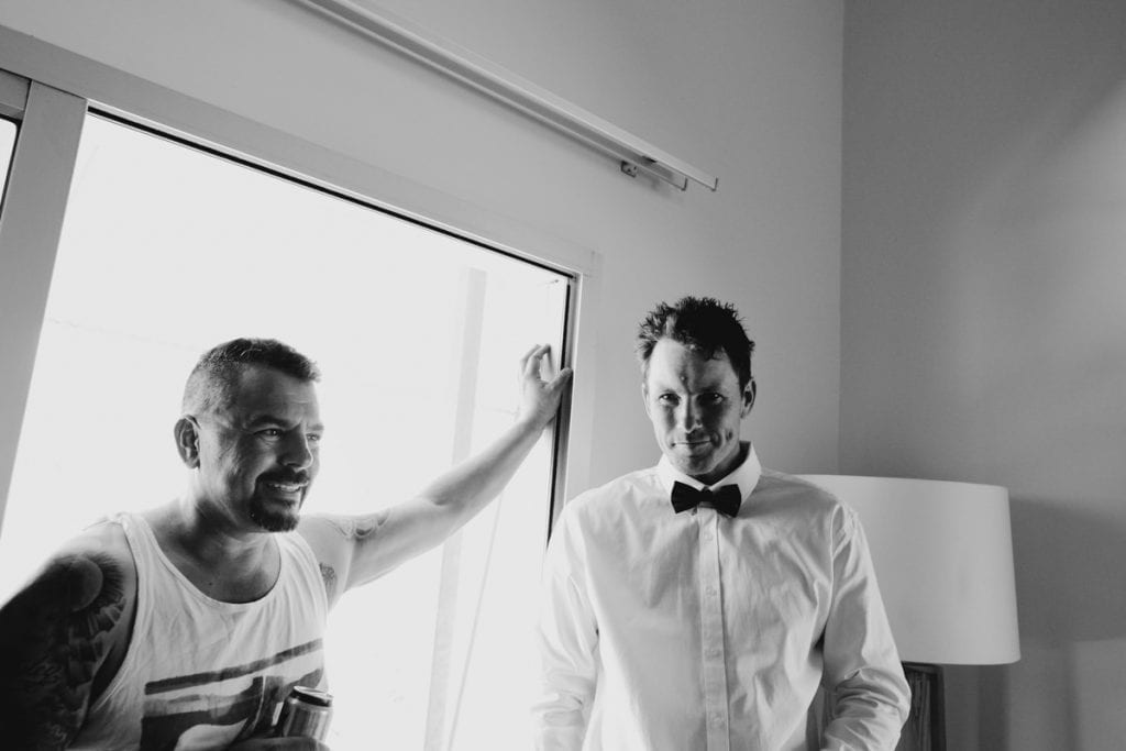 groom and his brother are getting ready for Eco Beach wedding