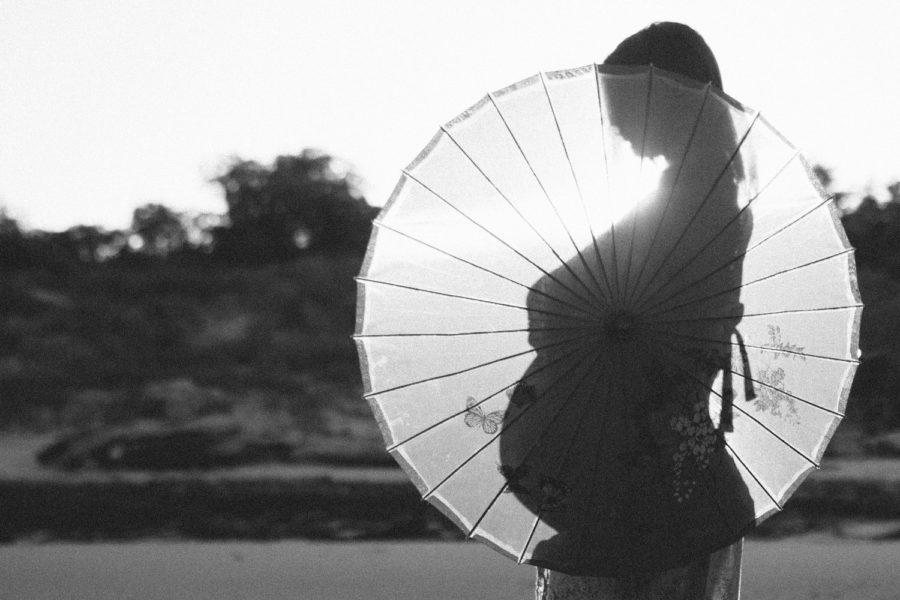 silhouette of pregnant woman and parasol