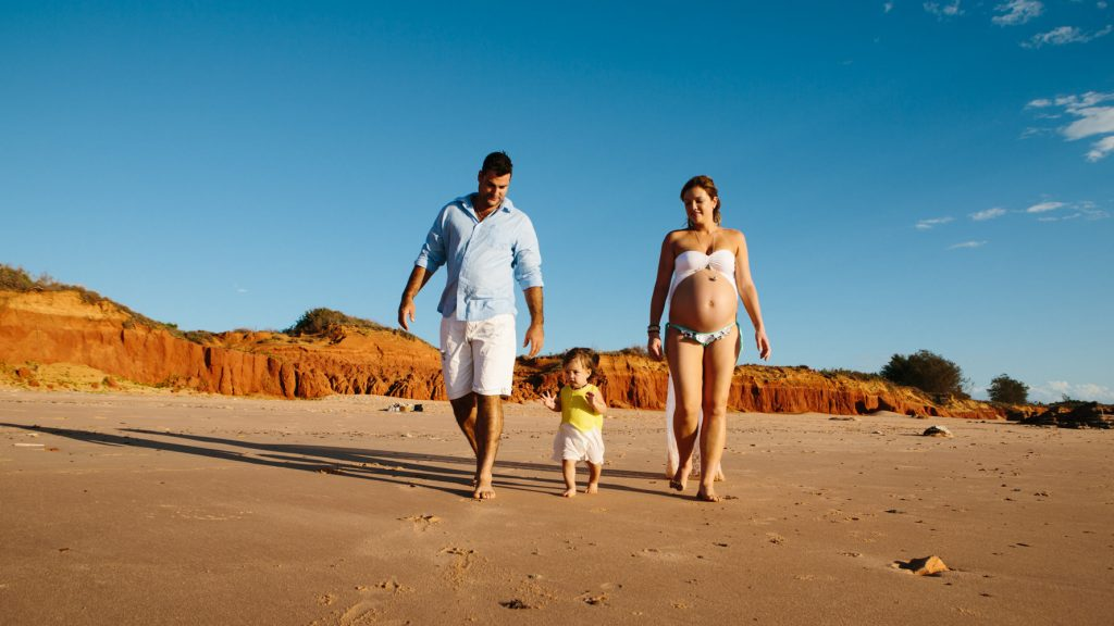 Family walking along Broome beach