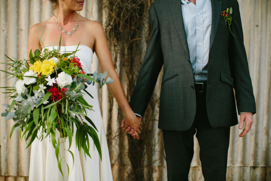 wedding couple holding hands in Broome