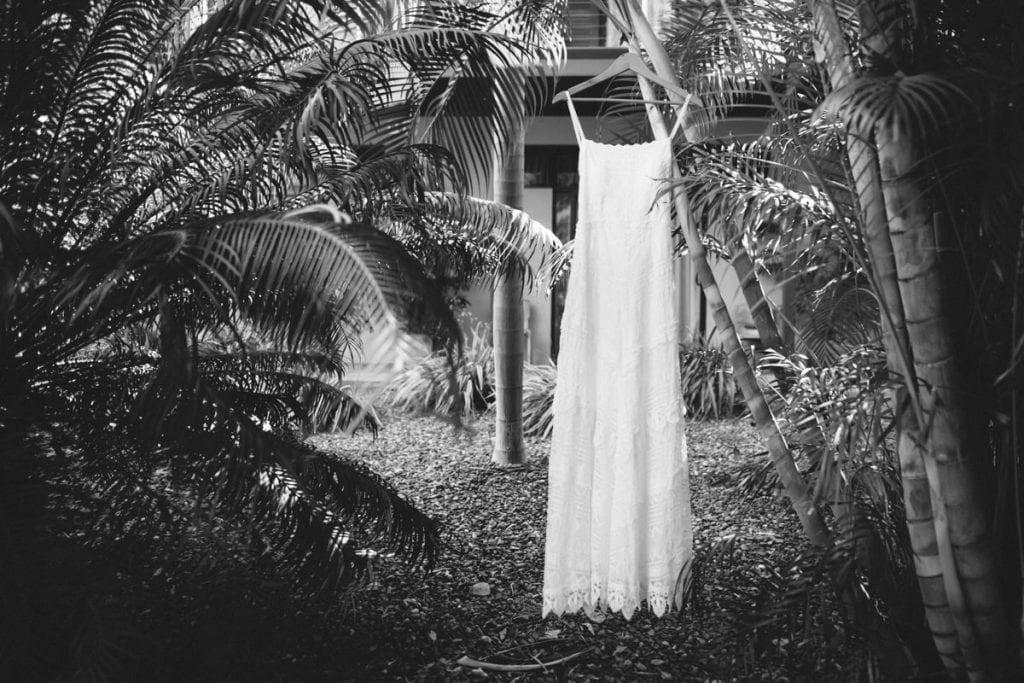 wedding dress amongst palm trees