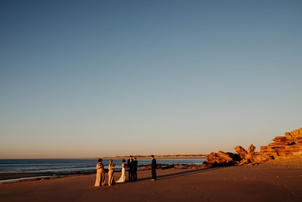 bridal party in golden light on Eco Beach