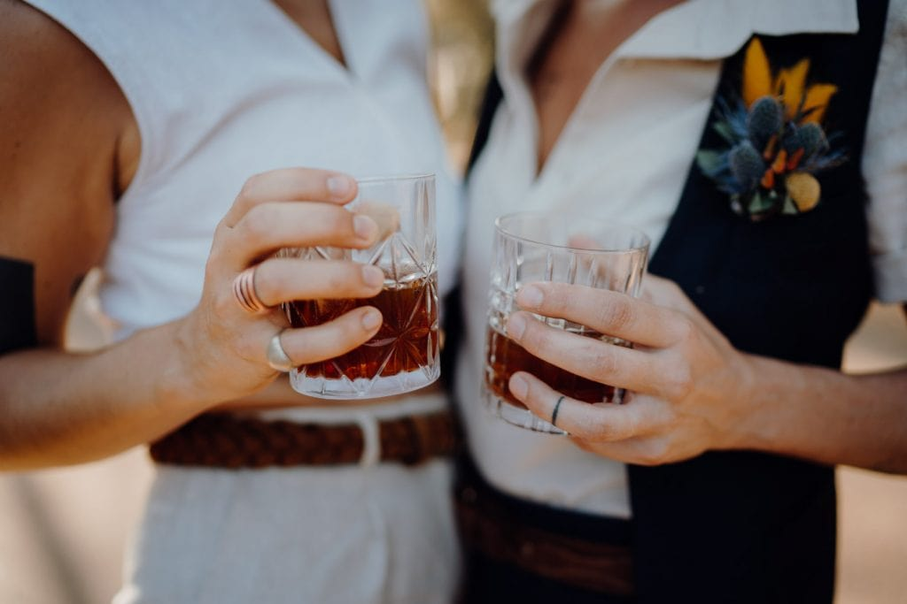 two people holding glasses with fernet branca at Broome elopement
