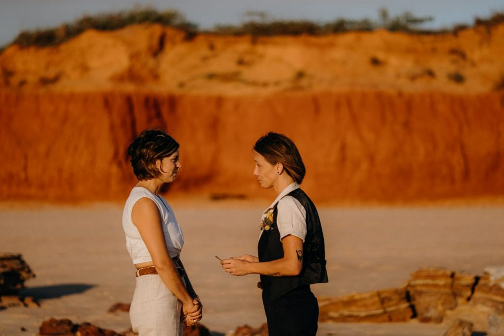 vow exchange between two women on Broome beach