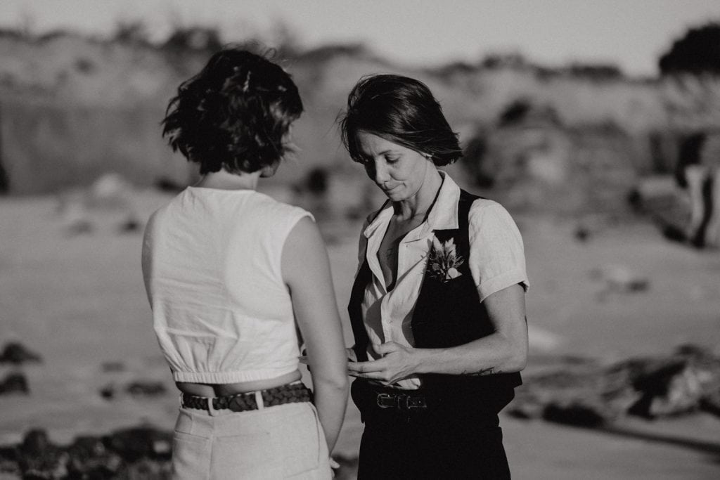 black and white image of two people sharing wedding vows at Broome elopement