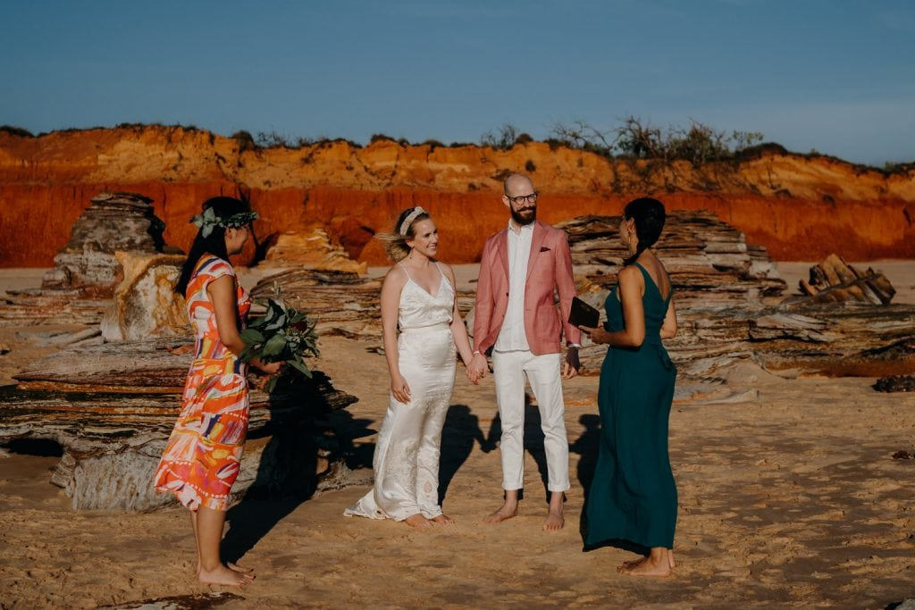 marriage celebrant Kelly Morrow conducts Broome elopement wedding on Reddell Beach in Broome with red cliffs as backdrop
