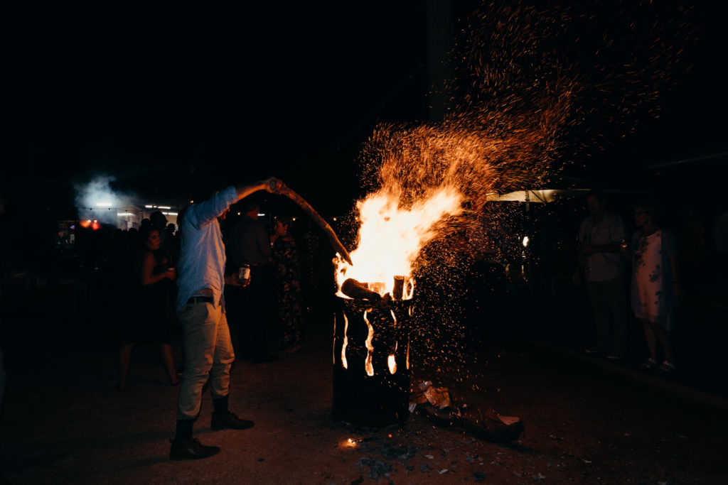 man attends bon fire at wedding