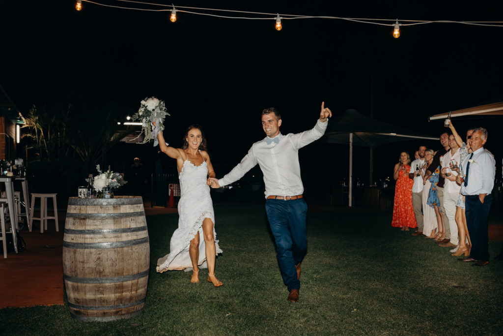 bride and groom entering their Broome Fishing Club wedding reception