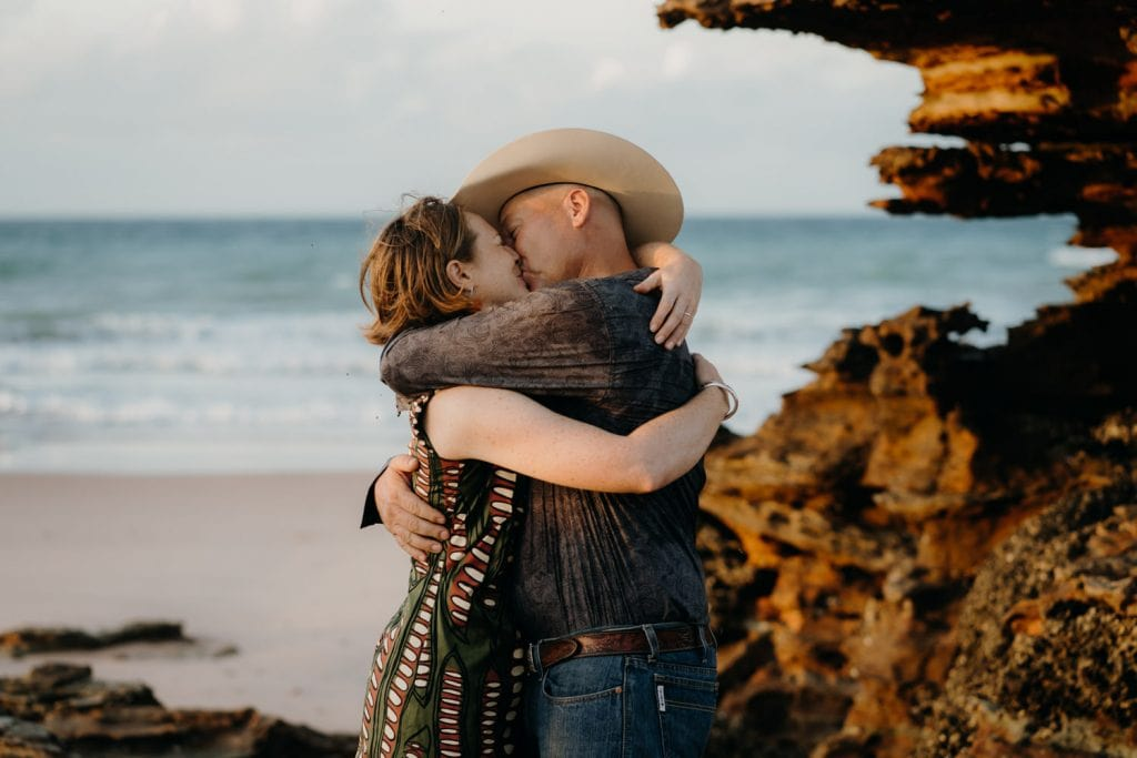 first kiss for this husband and wife at their sunrise wedding in Broome