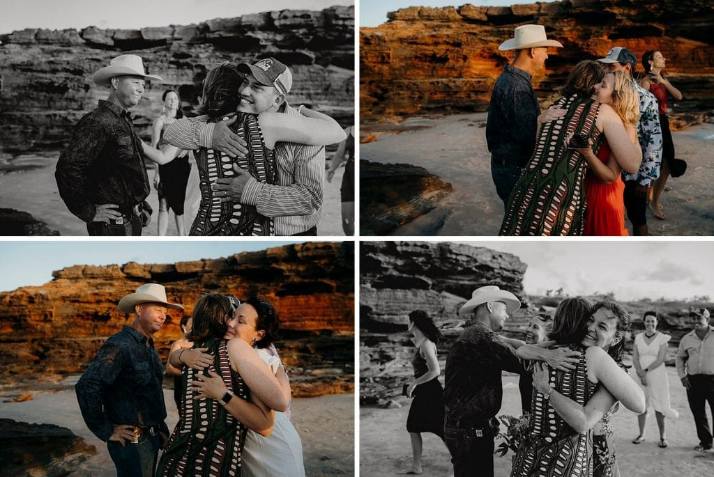 hugs and kisses from wedding guests to the newly weds on a remote beach in the Kimberley