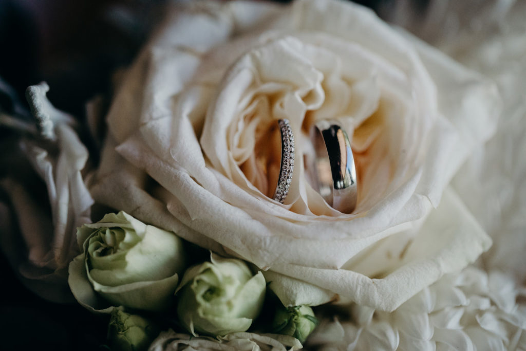 wedding rings tucked in a flower