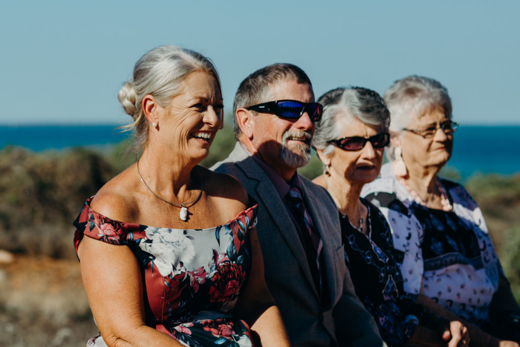 parents of the groom are looking on during the Broome Fishing Club wedding ceremony