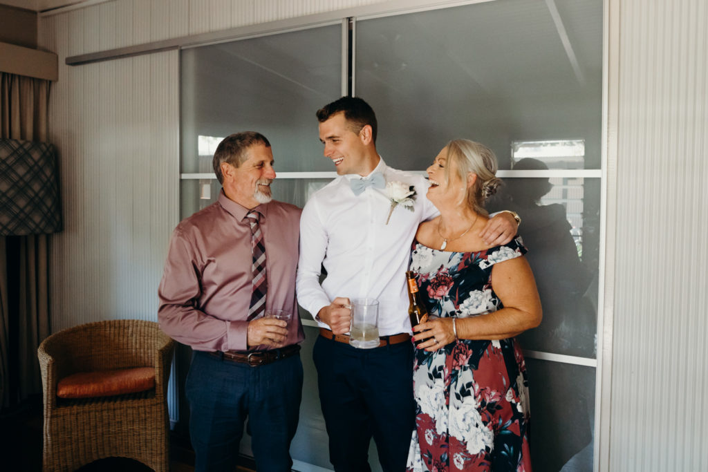 groom and his parents in hotel room before Broome Fishing Club wedding begins