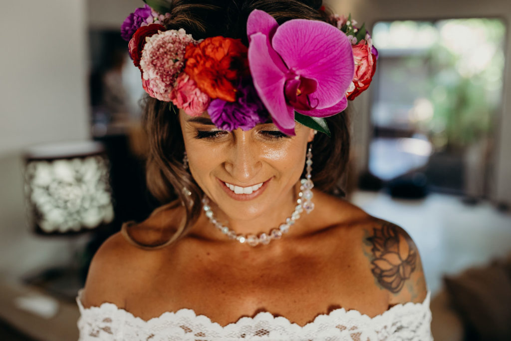 young bride with beautiful flower crown with orchids at Riddell Beach wedding