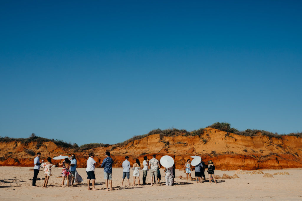Wedding guests on Riddell Beach wedding ceremony in Broome