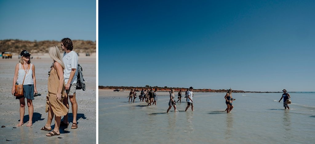 large group of people walking in the shallow water of Cable Beach in Broome to go Broome whale watching