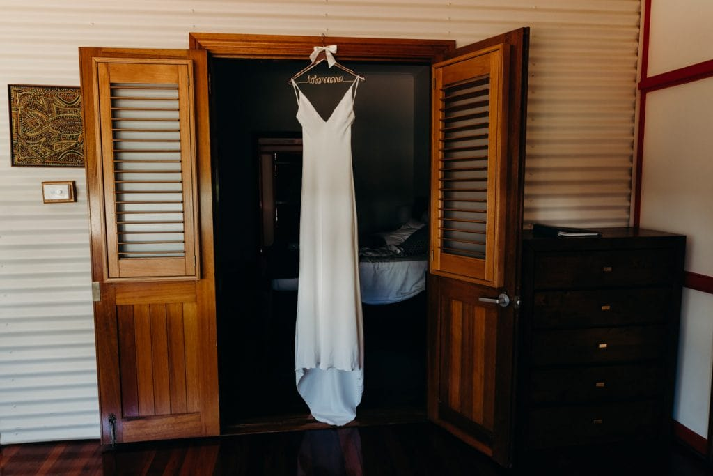 wedding dress on hanger at Cable Beach Club in Broome church wedding