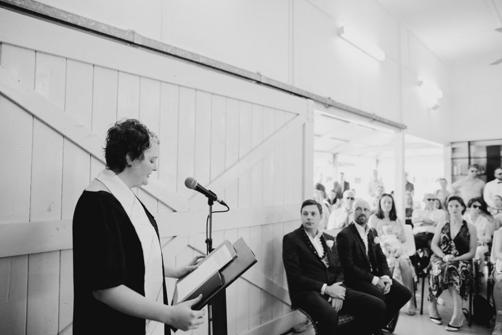 female pastor at Broome church wedding addresses the wedding guests and bride and groom with a speech