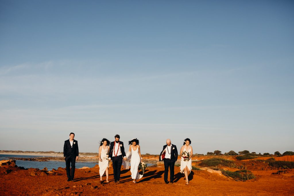 group of people walk at Gantheuame Point after Broome church wedding