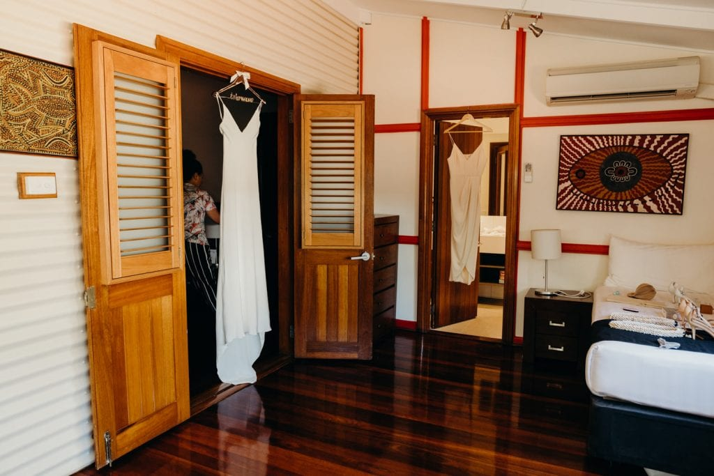 wedding dress hanging up in hotel room in Broome Cable Beach Club Resort