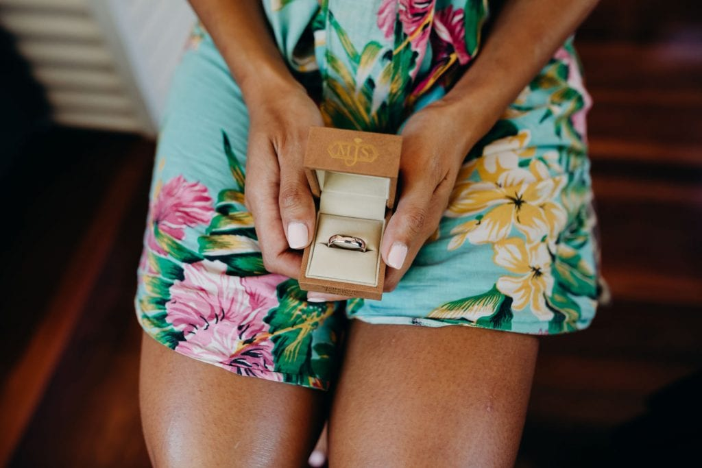 close up of wedding ring in brides box in brides hands