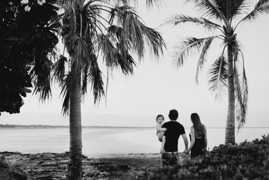 family of three overlooking a bay during their Broome maternity photography session