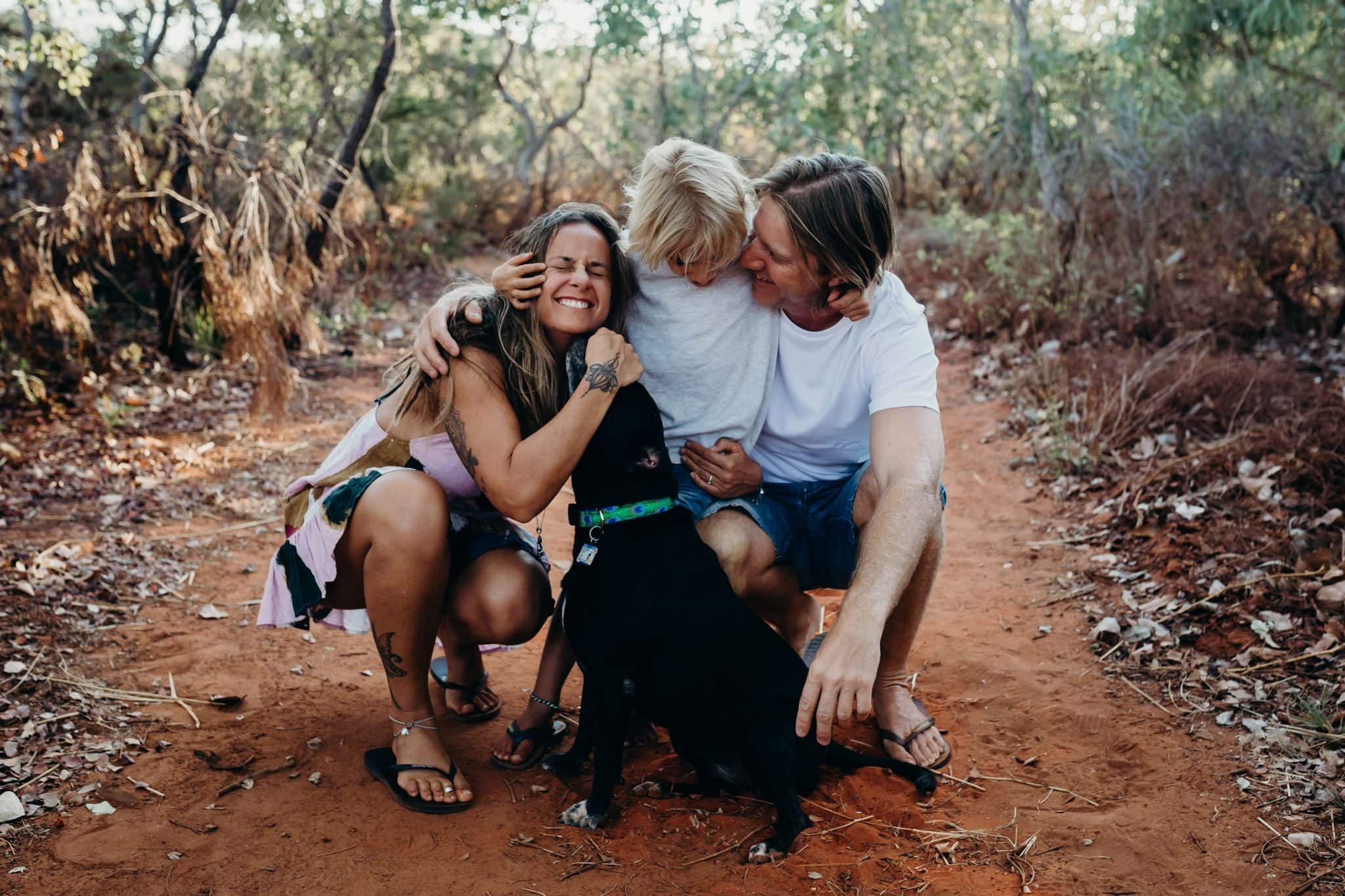 Broome family hugging with son and dog