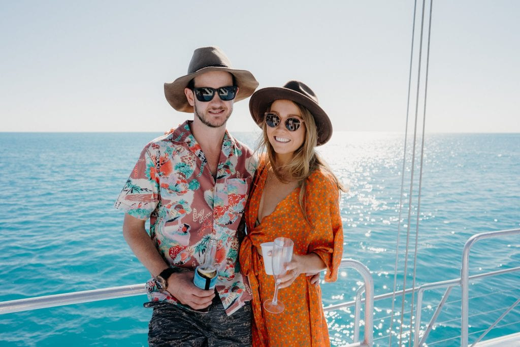 Broome wedding couple on whale watching boat wearing sunglasses and summery clothes