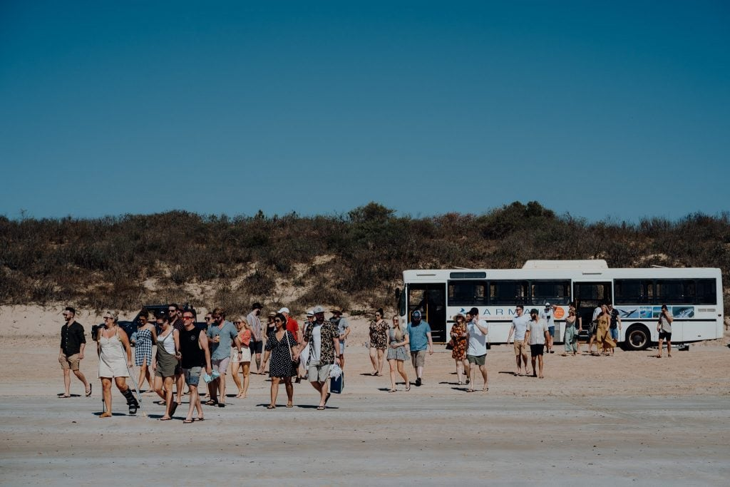 Wedding guests arriving for Karma IV Broome Whale Watching Cruise on Gantheaume Beach