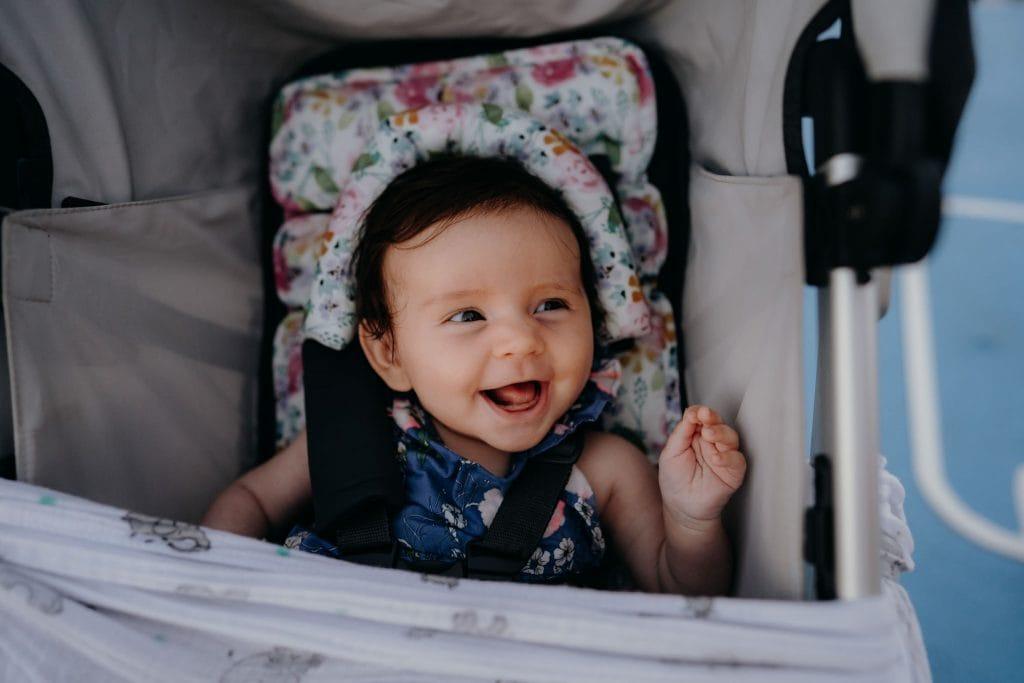 smiling baby in pram