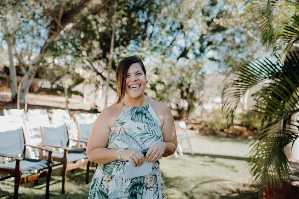 smiling woman in summery dress at garden wedding
