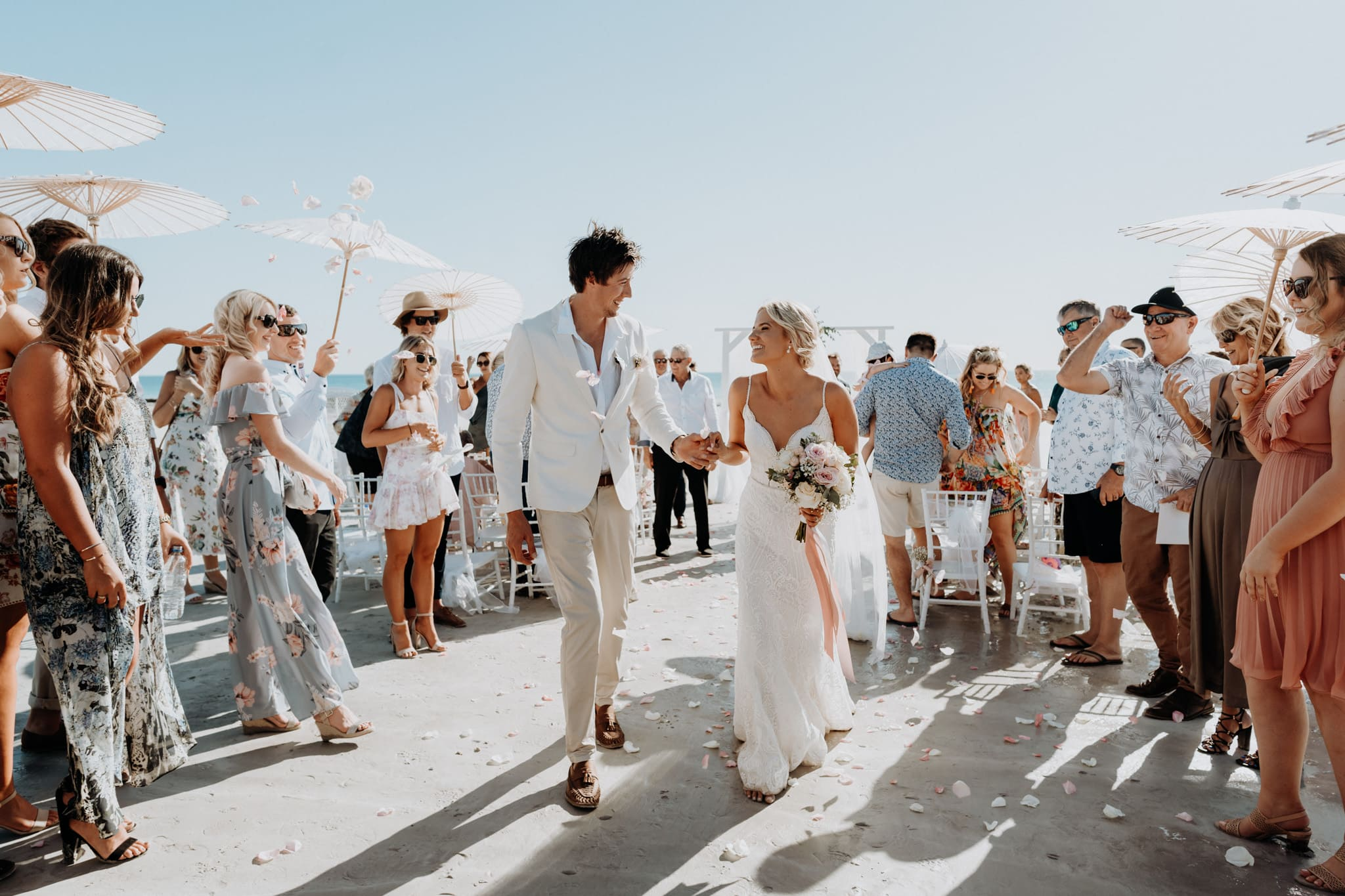 Bride and groom walking down the aisle at their Cable Beach Wedding