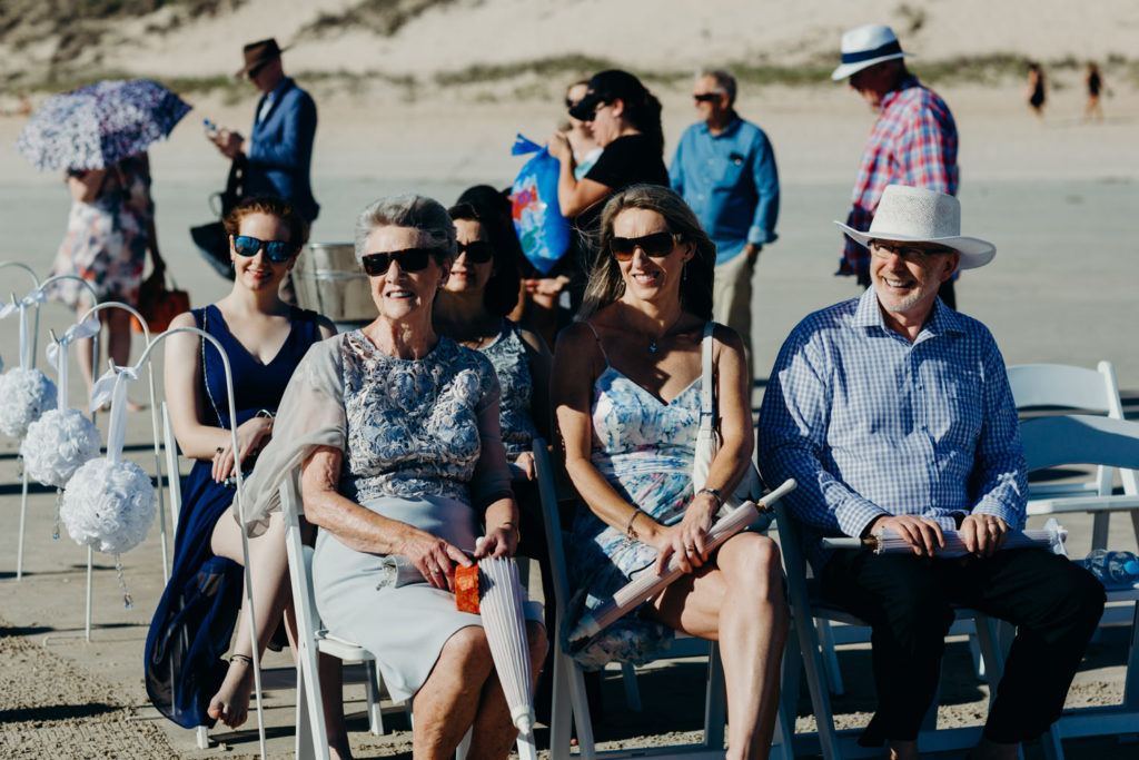 wedding guests seated at Cable Beach wedding surf club Broome watching the ceremony