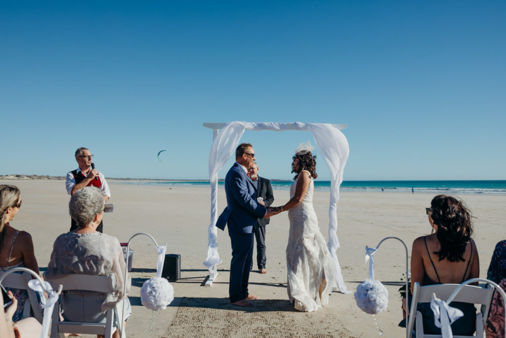 beach wedding on Cable Beach with barefoot bride and groom