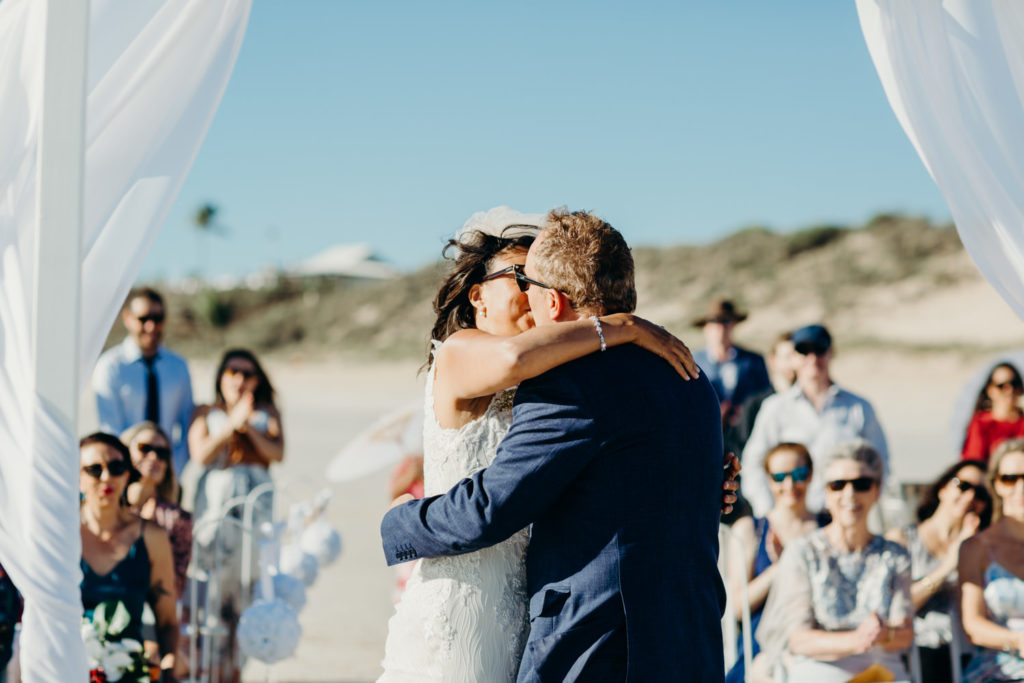 bride and groom kiss after they have been declared husband and wife on Cable Beach in Broome