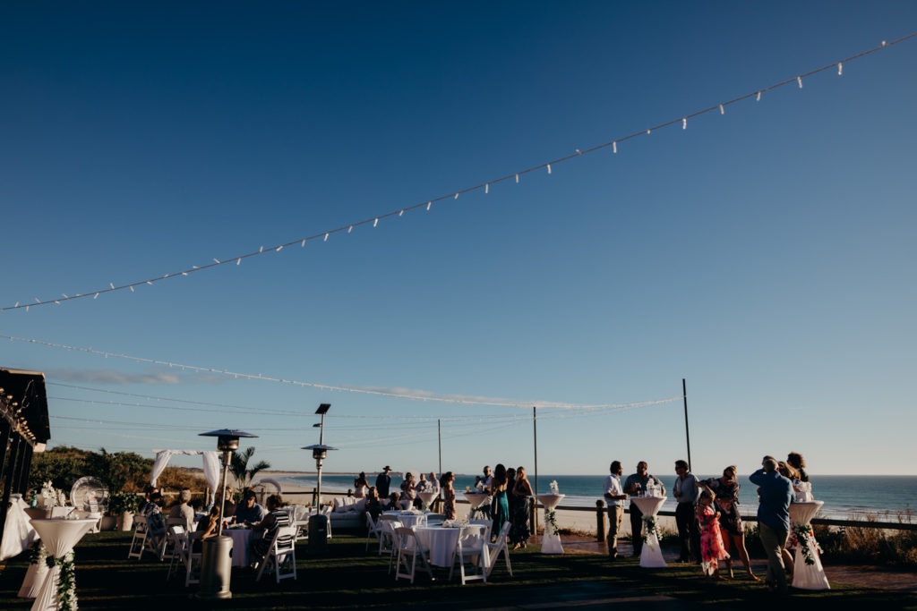 wedding guests mingling at Broome surf club overlooking Cable Beach