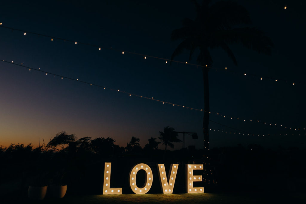 lit up love letter at Broome surf club wedding lighting up the dance floor