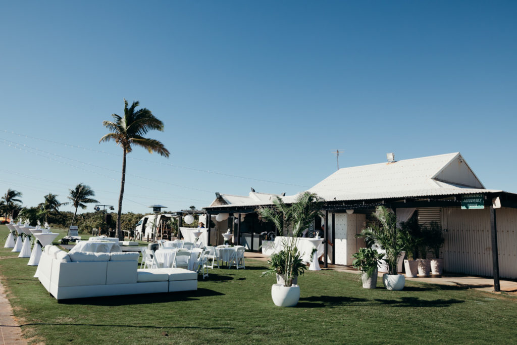 A Plus event styling set up for wedding at Broome surf club at Cable Beach with white sofas and greenery