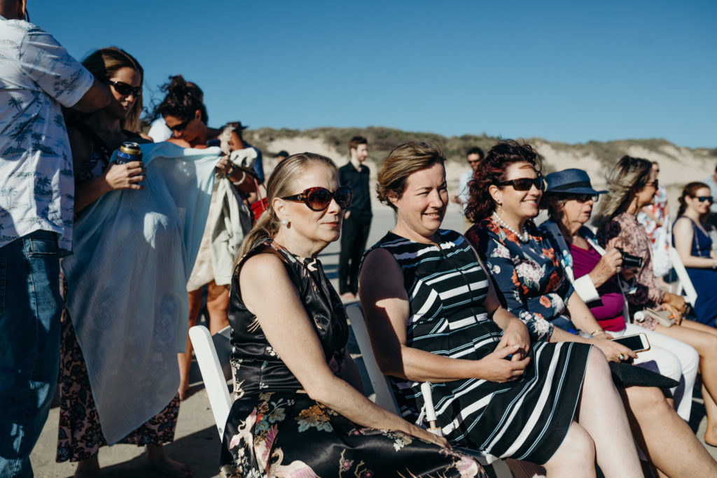 wedding guests in summer dresses at Broome wedding near surf club