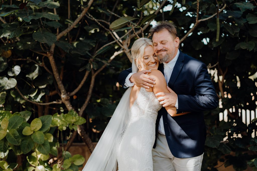 father of the bride gives his daughter a hug on her wedding day