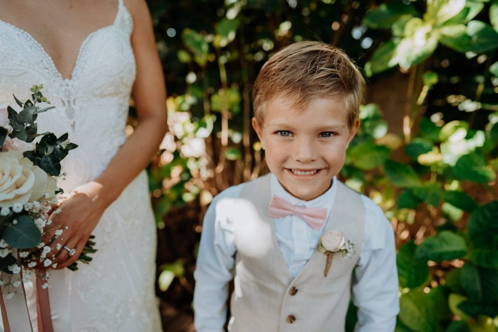 little boy in wedding attire and bow tie